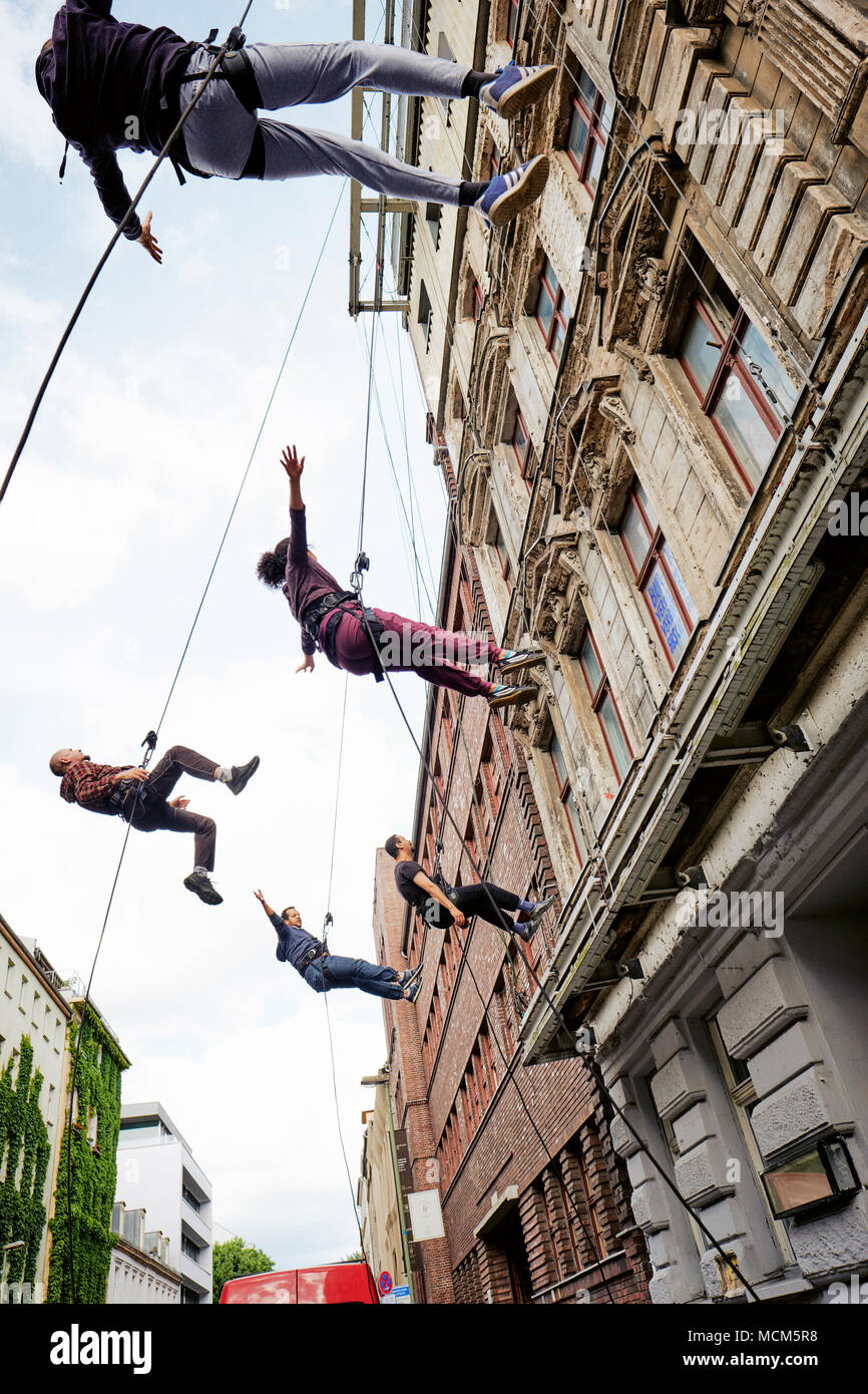 The Berlin street theatre group called Grotest Maru rehearsing in Auguststrasse in Berlin Germany EU. - Stock Image