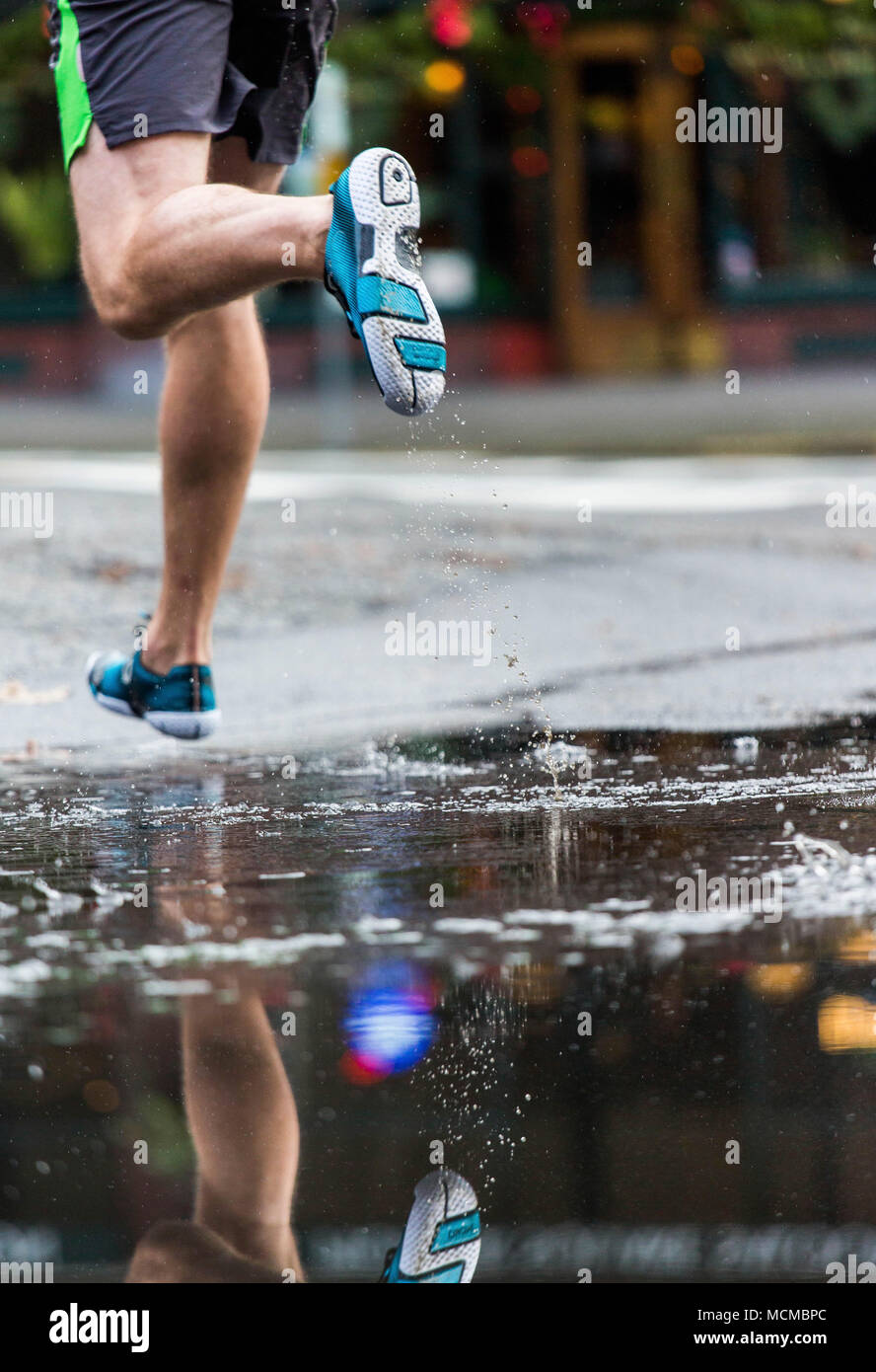 Low section of runner jogging in street, Pioneer Square, Seattle, Washington State, USA - Stock Image