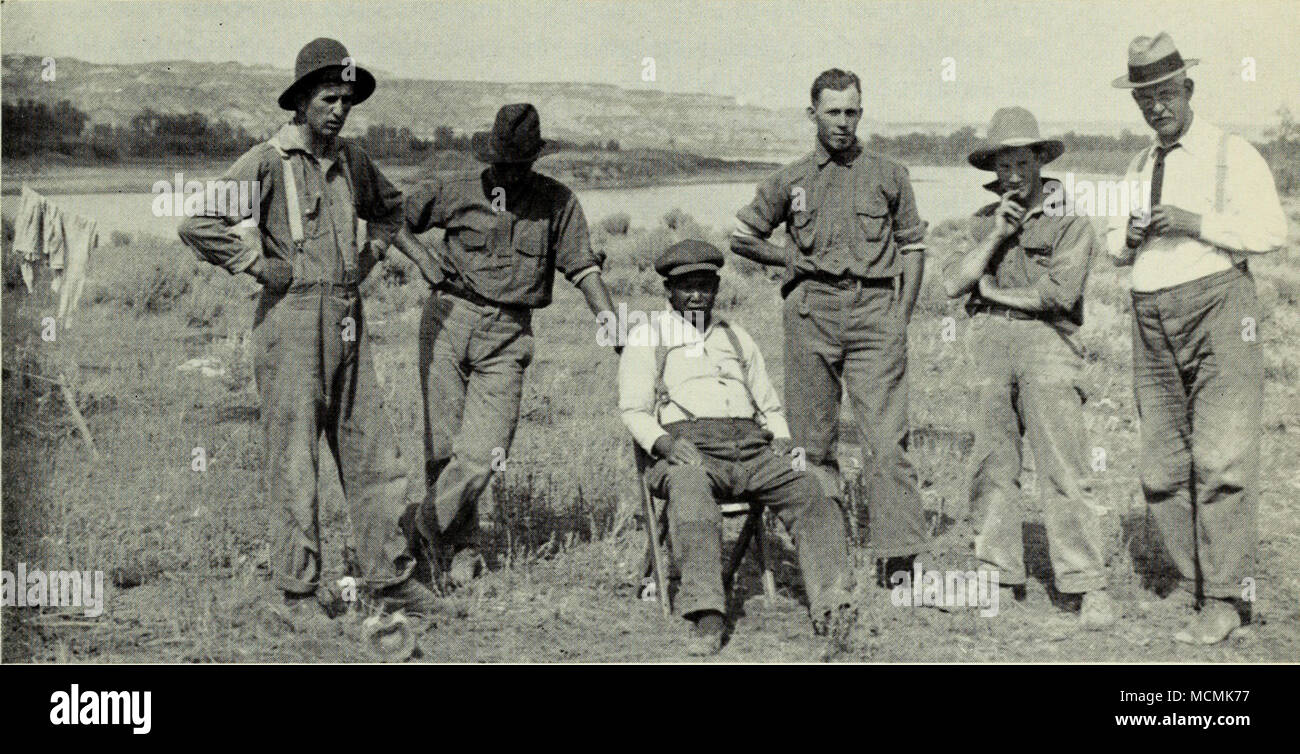 . Royal Ontario Museum expedition of 1921, Red Deer River near Little Sandhill Creek. LEFT TO right: two assistants, Chinese cook, G. E. Lindblad, L. Sternberg, Dr. W. A. Parks (visiting). N.M.C., No. 46586. Collecting was shifted to the Edmonton formation in 1922. A fourth man was added to the permanent staflf, John Rickett of Toronto. The northern Red Deer River badlands were explored from the vicinity of Big Valley to the area around Morrin ferry. Specimens collected included the skull of a hooded duck-billed dinosaur (Hypacrosaurus), the incomplete skull of a horned dinosaur (Anchiceratops - Stock Image