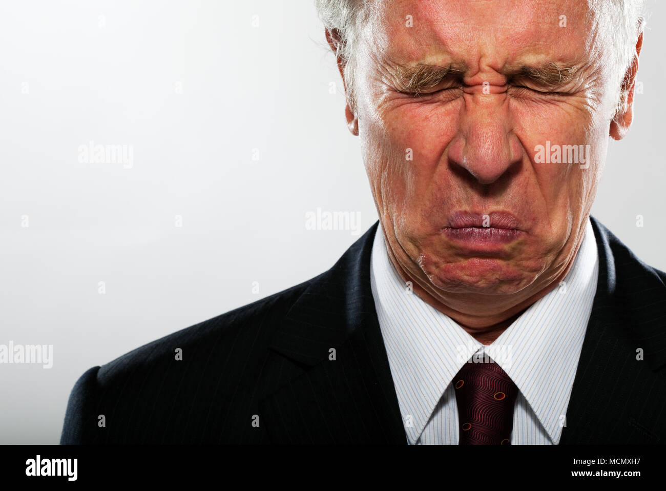 Middle aged man with sour expression - Stock Image