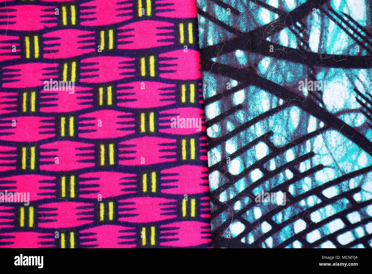 Tanzanian patterned kitenge fabric. The printing is done using a traditional batik technique. - Stock Image