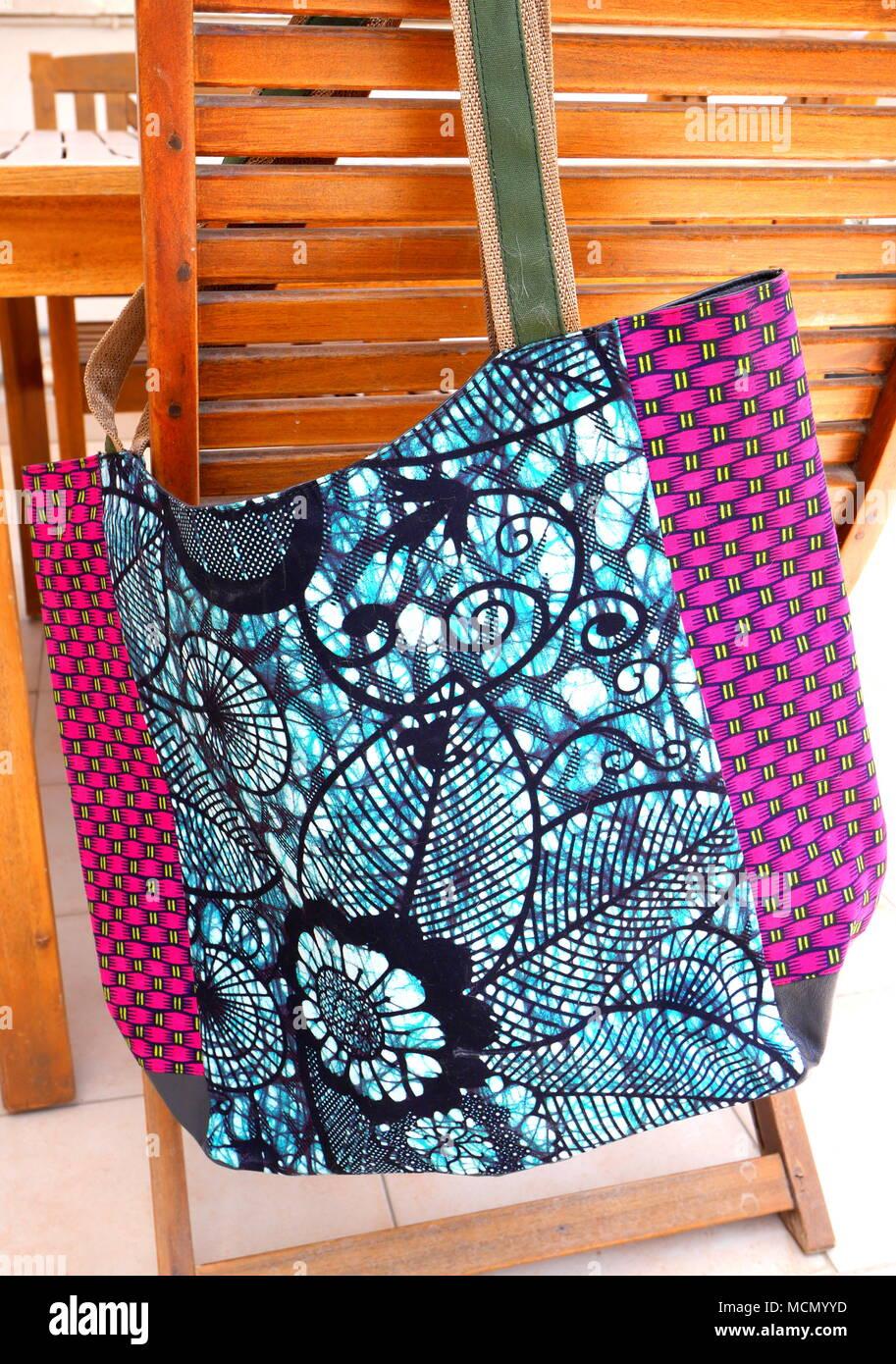 Colourful Tanzanian bag made out of kitenge fabric - Stock Image