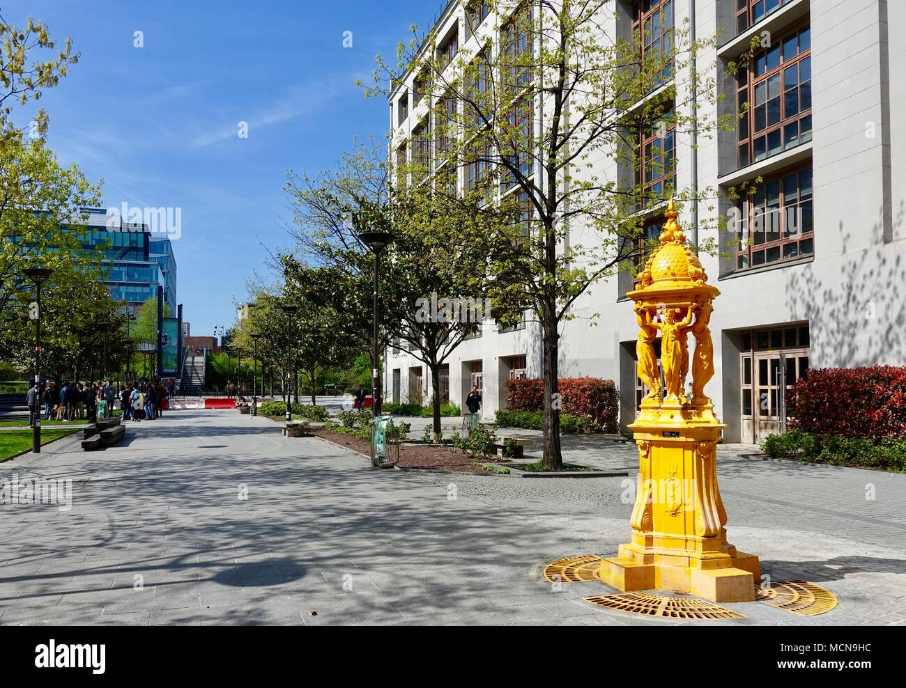 Yellow Wallace Fountain on University campus, Diderot. Paris, France - Stock Image