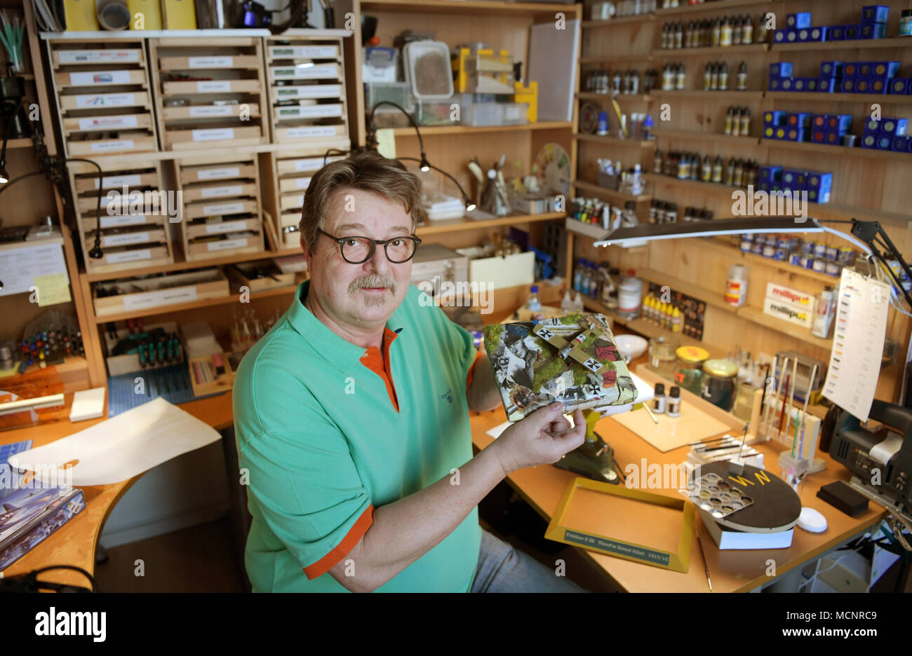 17 April 2018, Duesseldorf, Germany: The model builder Lutz Bellmann sitting with a Revell model in his private workshop. After the bankruptcy of the parent company Hobbico in the USA, the model builder company is to be sold to a Munich investor group. Photo: Ina Fassbender/dpa - Stock Image