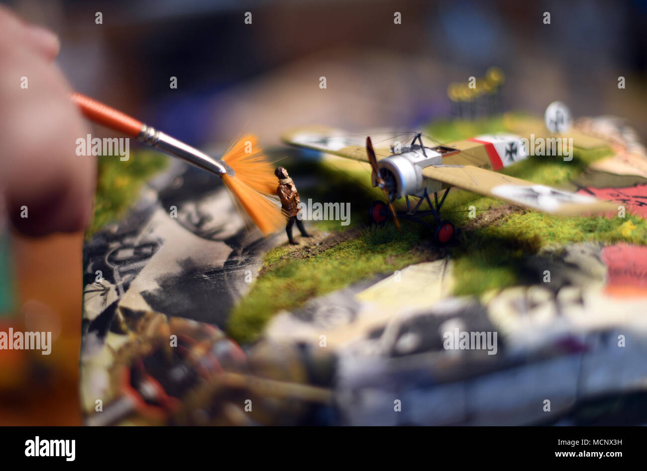17 April 2018, Duesseldorf, Germany: The model builder Lutz Bellmann cleaning a 'Fokker E3' Revell model in his private workshop. After the bankruptcy of the parent company Hobbico in the USA, the model builder company is to be sold to a Munich investor group. Photo: Ina Fassbender/dpa - Stock Image