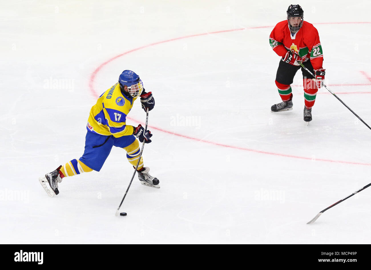 Kiev, Ukraine. 17th April, 2018. Olexander PERESUNKO of Ukraine shots a puck during the IIHF 2018 Ice Hockey U18 World Championship Div 1 Group B game against Hungary at Palace of Sports in Kyiv, Ukraine. Credit: Oleksandr Prykhodko/Alamy Live News - Stock Image
