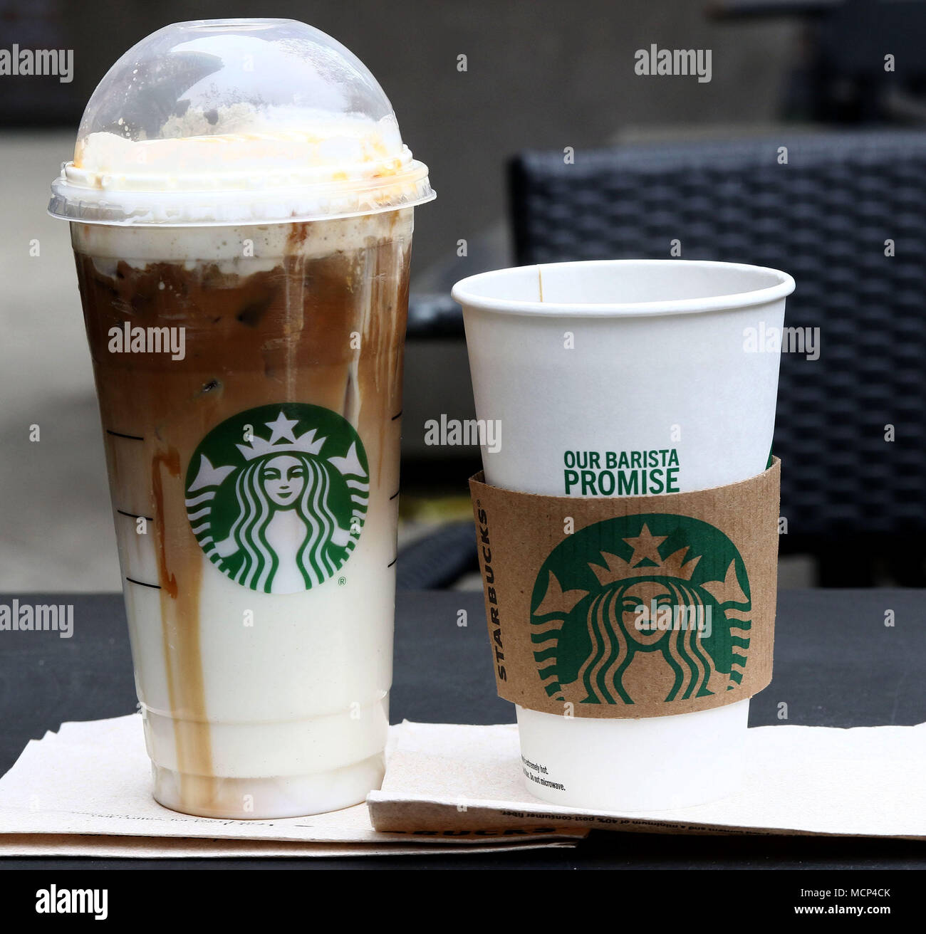 A View Of Starbucks Iced Caramel Macchiato And Black Coffee After It Was Announced That Will Close 8000 Stores For An