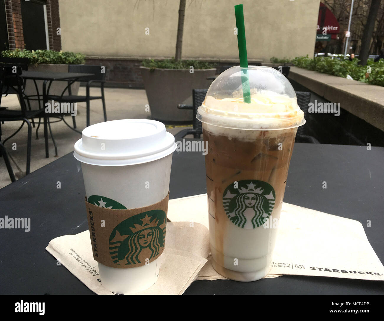 A View Of Starbucks Black Coffee And Iced Caramel Macchiato After It Was Announced That Will Close 8000 Stores For An