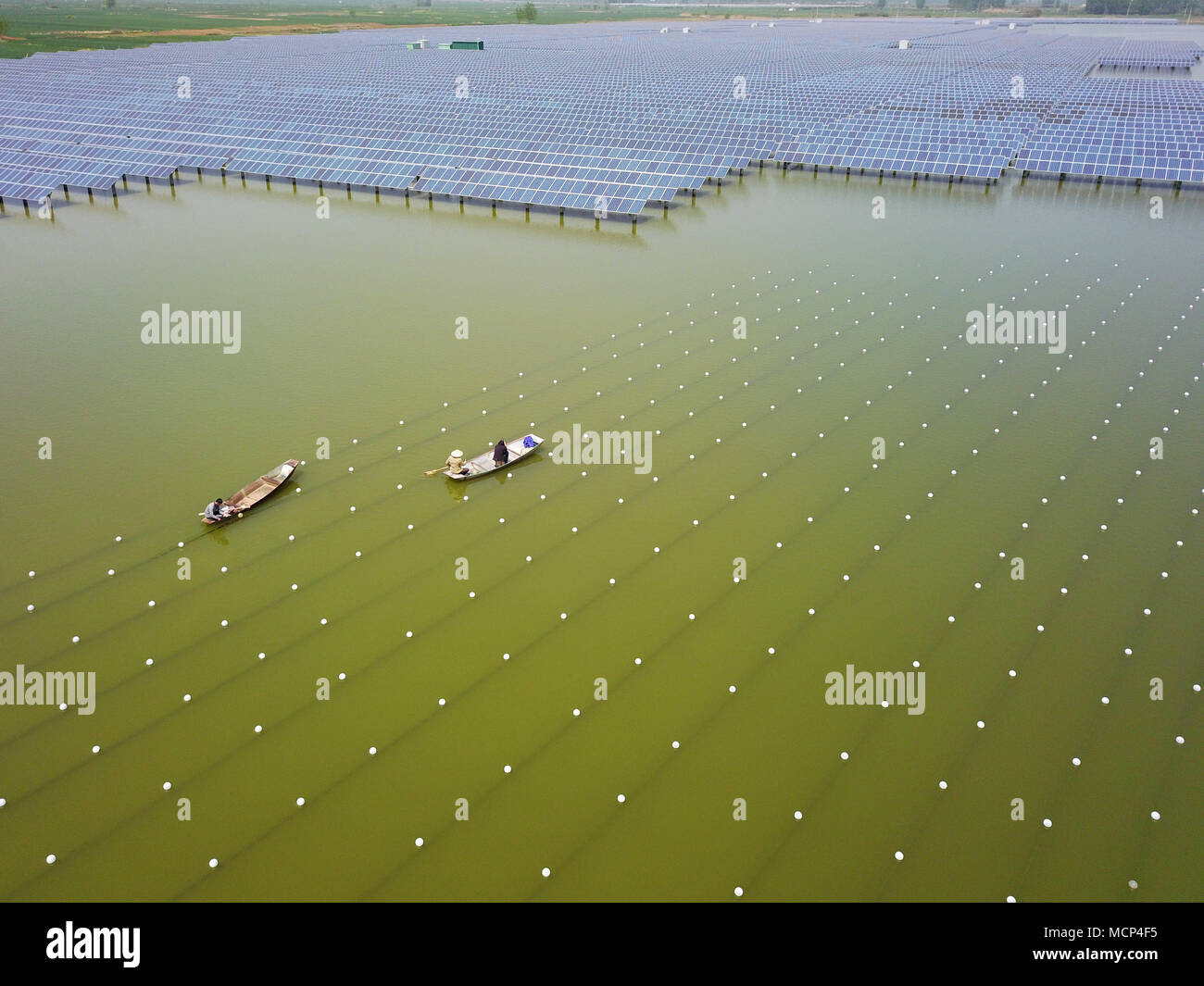 Aerial Photo Taken On April 17 2018 Shows People Working At A Pearl Farm In The Reservoir Installed With Solar Panels Weiying Town Of Sihong County