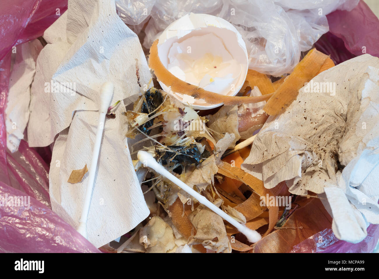 Remains of food in trash can. Organic waste in trash can. - Stock Image