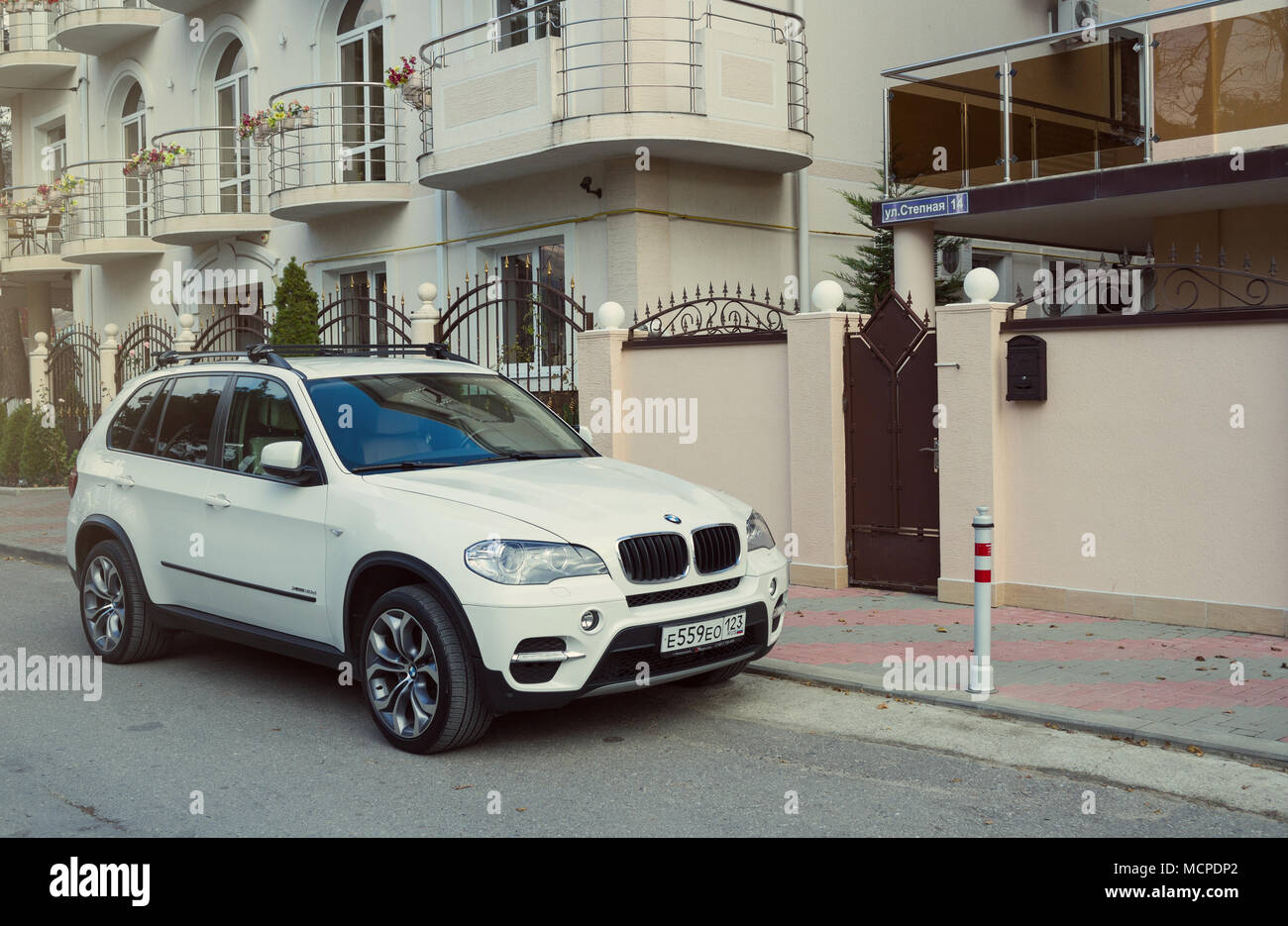 Novorossiisk, Russia - November 26, 2017: New luxury BMW x5 parked near house in street of the Sochi city. - Stock Image