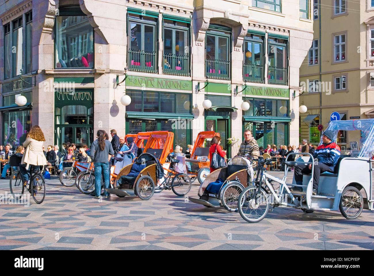 COPENHAGEN, DENMARK - APRIL 13, 2010: Pedicabs on car free zone Stroget. Located near Amagertorv and Fountain Stork - Stock Image