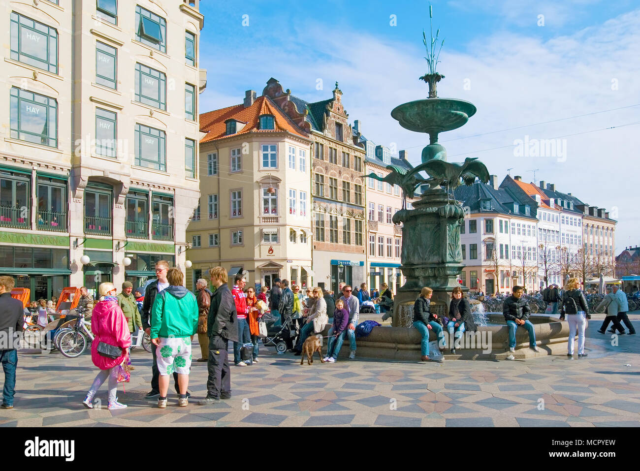 COPENHAGEN, DENMARK - APRIL 13, 2010: Many people near fountain Stork on Amagertorv Square. Carfree zone Stroget - Stock Image