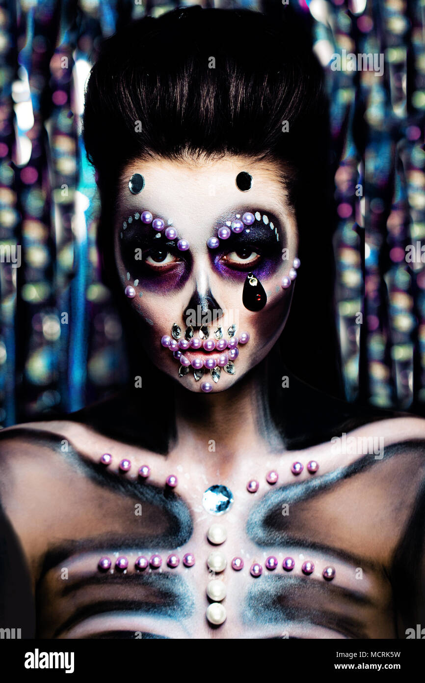 Halloween Make Up Skelet.Halloween Woman With Halloween Makeup On Colorful Bokeh
