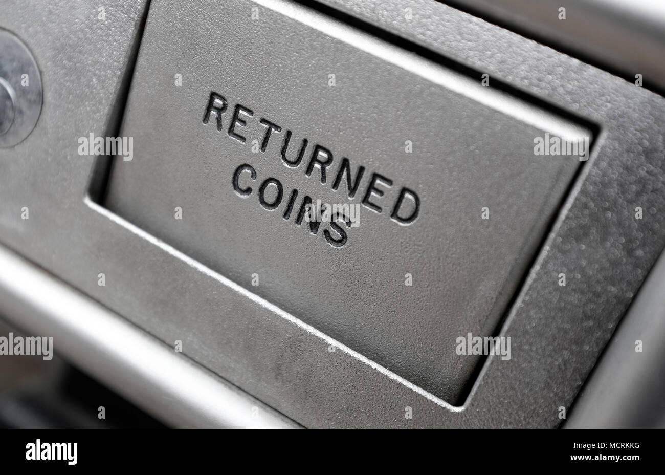 returned coins cover on metal payphone, norfolk, england - Stock Image