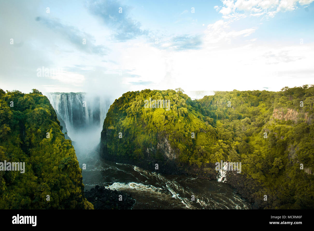View of the Victoria Falls or Mosi oa Tunya. It is the widest curtain of water in the world and one of the Natural Wonders. - Stock Image