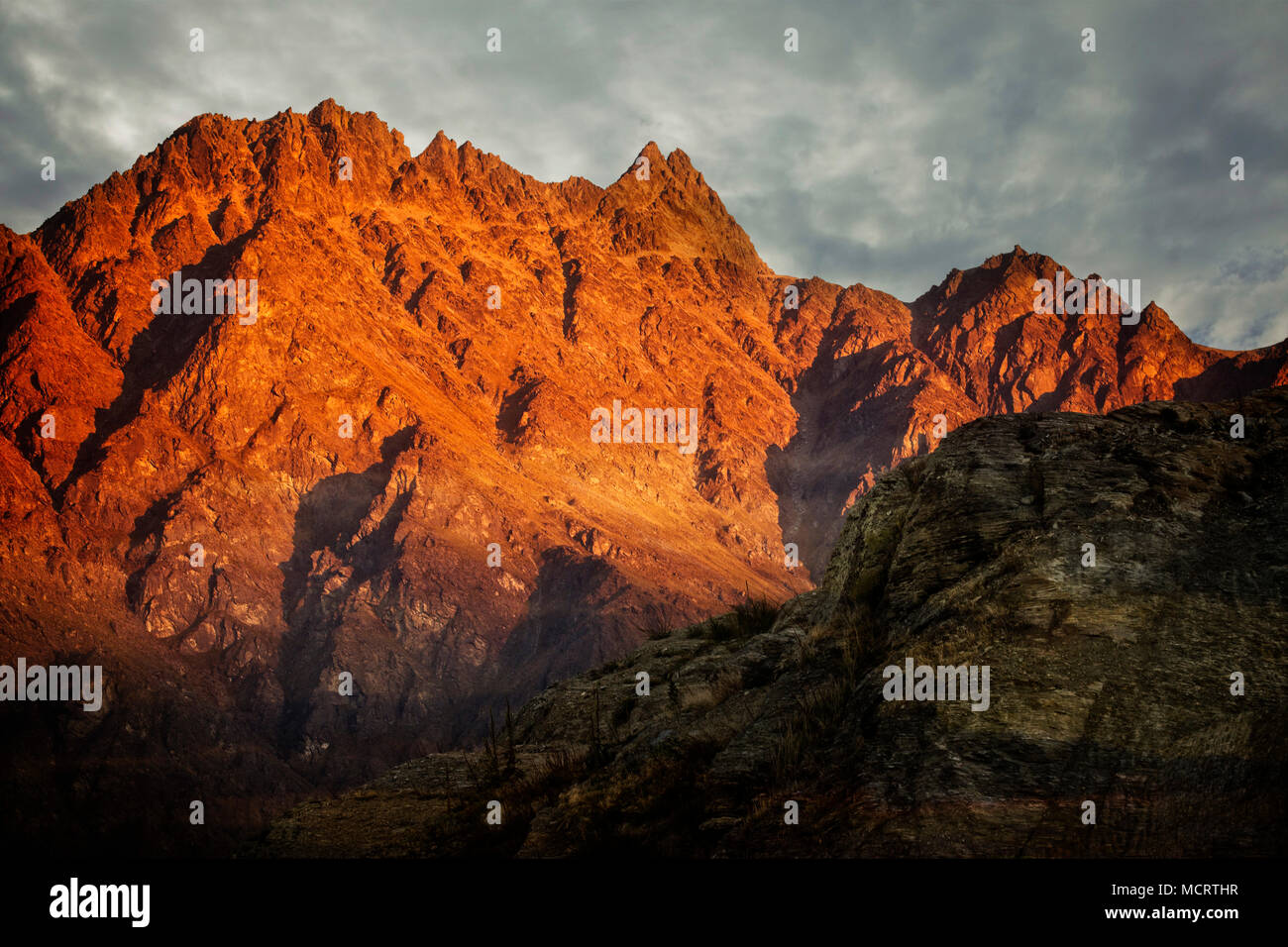 Sunset on the Remarkable mountain range near Queenstown, South Island, New Zealand. - Stock Image