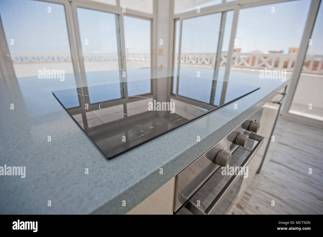 Interior Design Decor Showing Modern Kitchen And Cooker Appliance In Luxury Penthouse Apartment Showroom With Panoramic Patio Windows Stock Photo Alamy