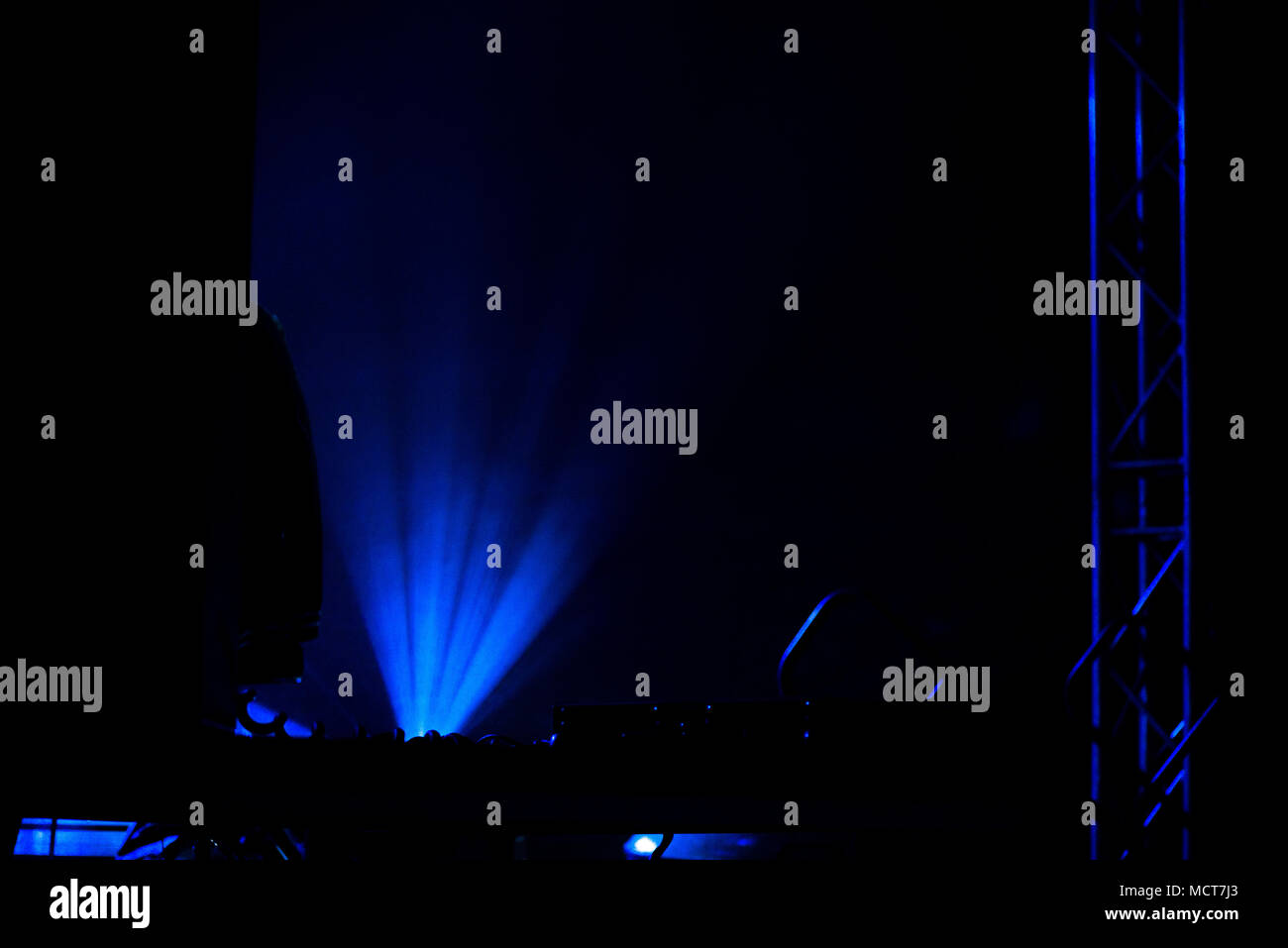 Laser show. Live concert of electronic music at night in summer festival. Colorful, abstract stage lights - Stock Image