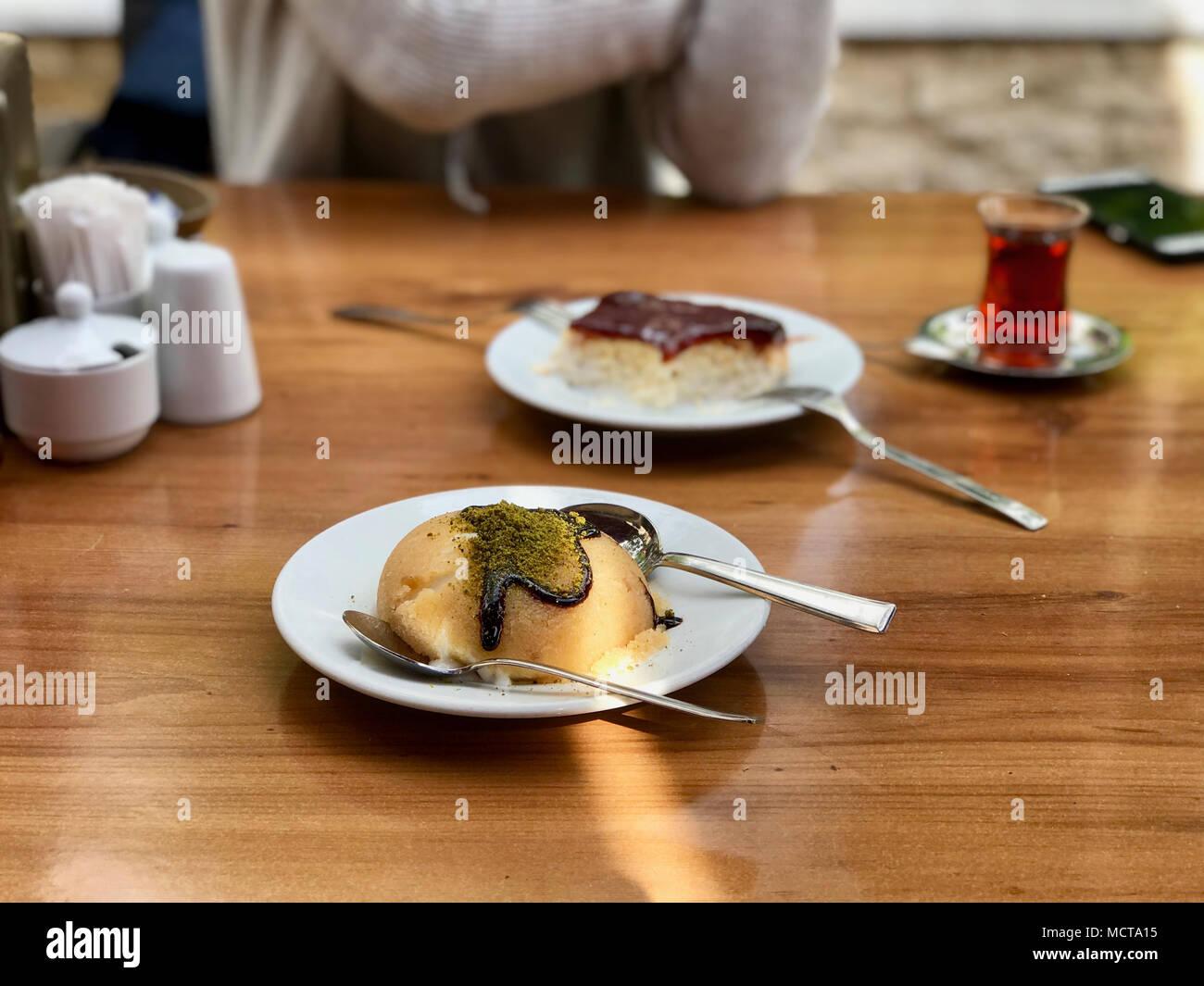 Semolina Dessert with ice cream / irmik helvasi / halva. Traditional Dessert. - Stock Image