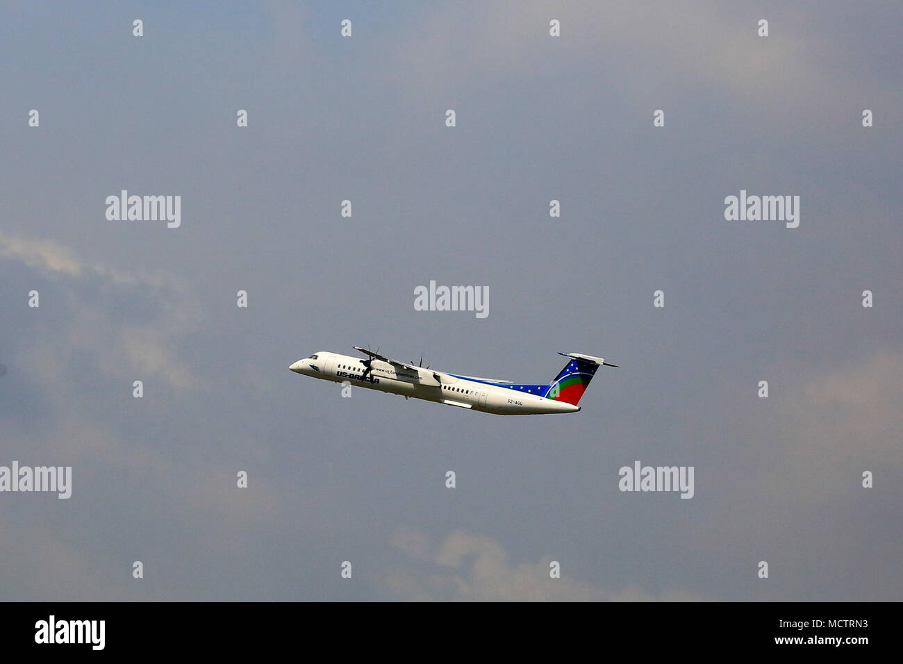 US Bangla Airlines Bombardier Dash 8 Q–400 aircraft flying from the Hazrat Shahjalal International Airport. This aircraft crashed at Tribhuvan Interna - Stock Image