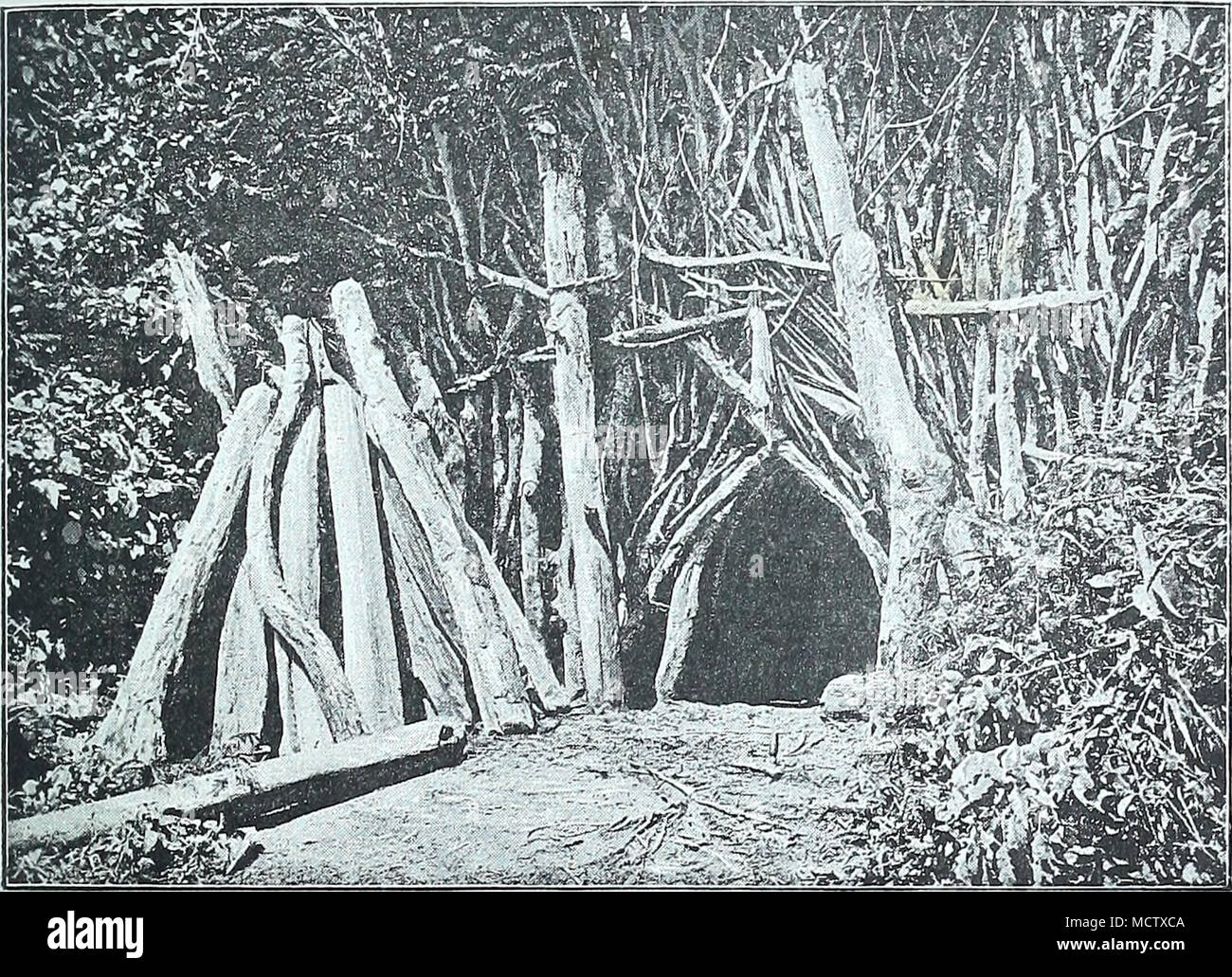 . ONE OF THE ENTRANCES TO TAVETA. there would be a danger of our losing everything, or at least of having everything damaged. Opposite to this hut were the stables for the donkeys and goats, a big workshop, and the kitchen; whilst the tents of the men were arranged in circles round this central nucleus, the paths between our quarters and theirs being usually pretty full of natives. The first of them generally appeared quite earty in the morning, bringing fish for sale—plump fellows caught in baskets in the Lumi, VOL. I. H - Stock Image