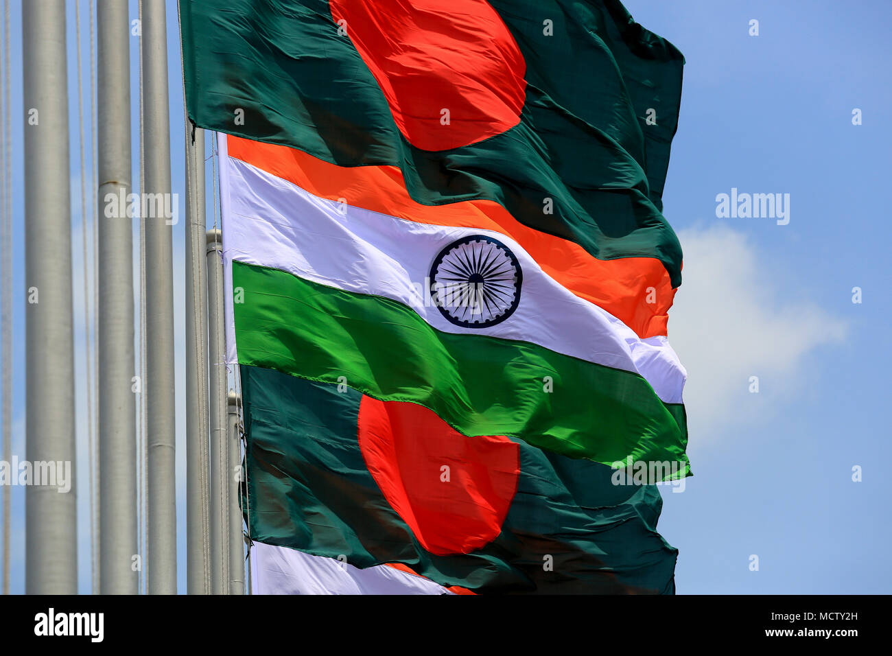 Bangladesh and India flags flutter side by side. - Stock Image