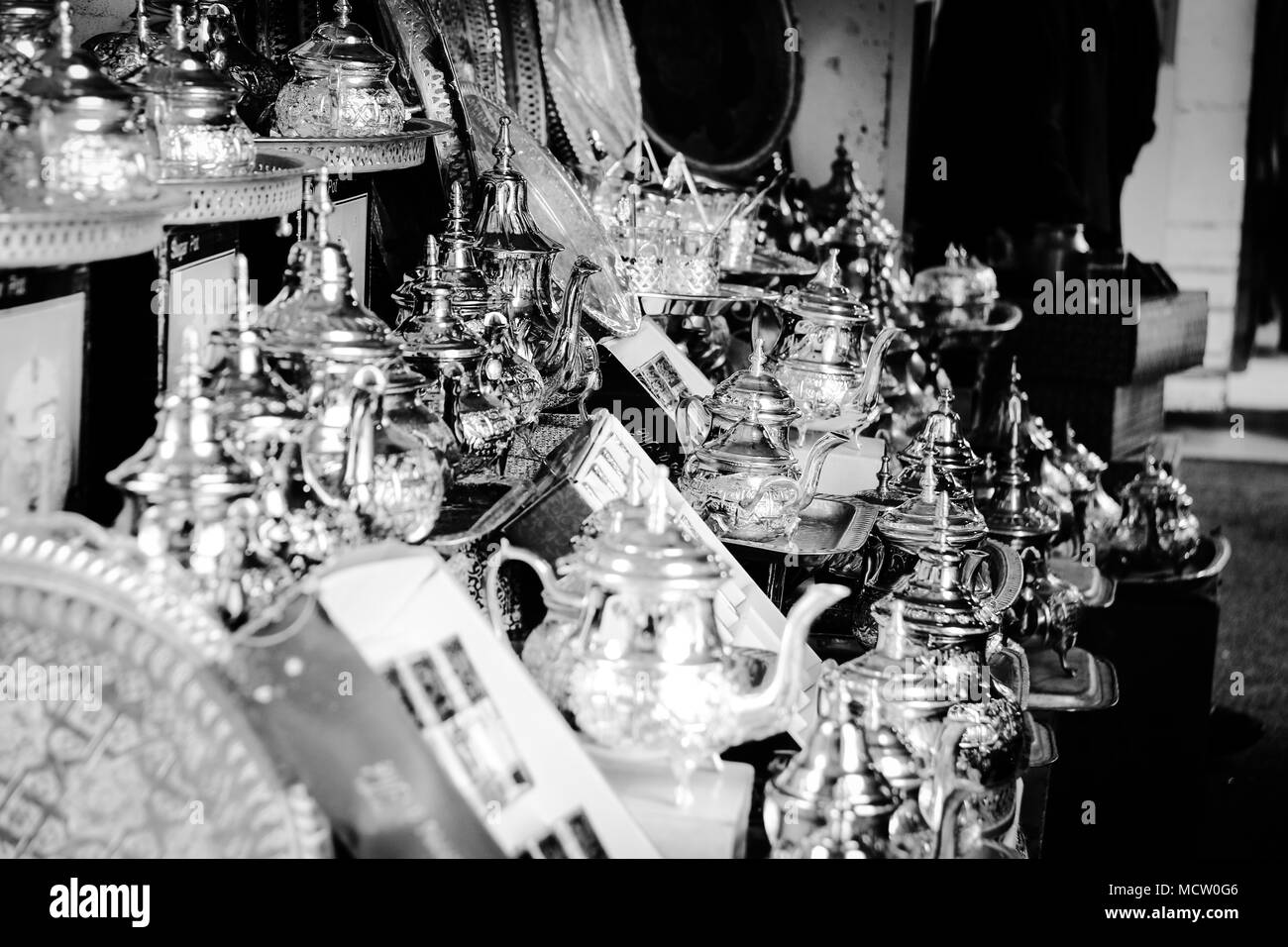 Black and white picture of traditional tin cans and tea cups at the old souk in Casablanca, Morocco Stock Photo
