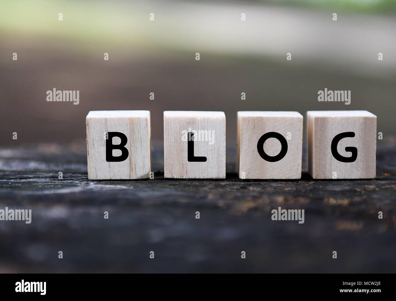 Blog word on wood blocks with blurry background. - Stock Image