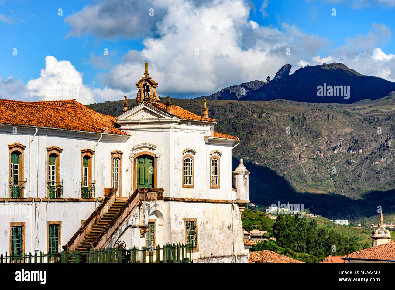Top view of historic Ouro Preto city in Minas Gerais, Brazil with its famous churches and old buildings with hills in background - Stock Image