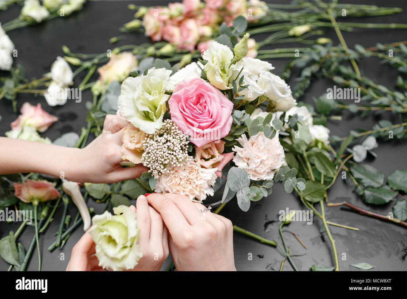 Master class on making bouquets for kids. Spring bouquet in metal ornamental flowerpot. Learning flower arranging, making beautiful bouquets with your own hands Stock Photo