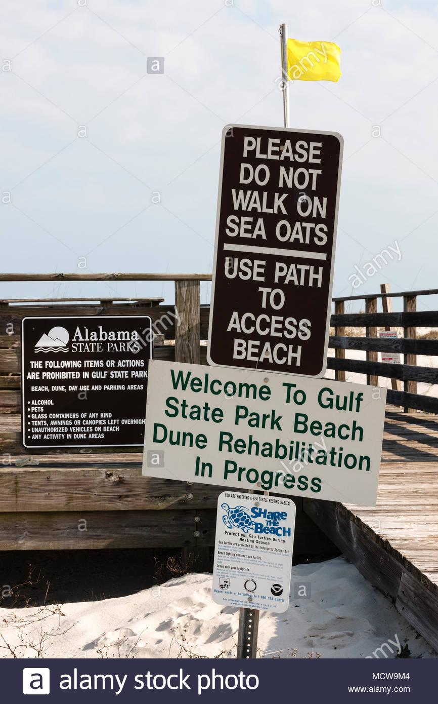 Beach signs at the entrance of the boardwalk leading to the beach at Gulf State Park, Gulf Shores, Alabama Stock Photo