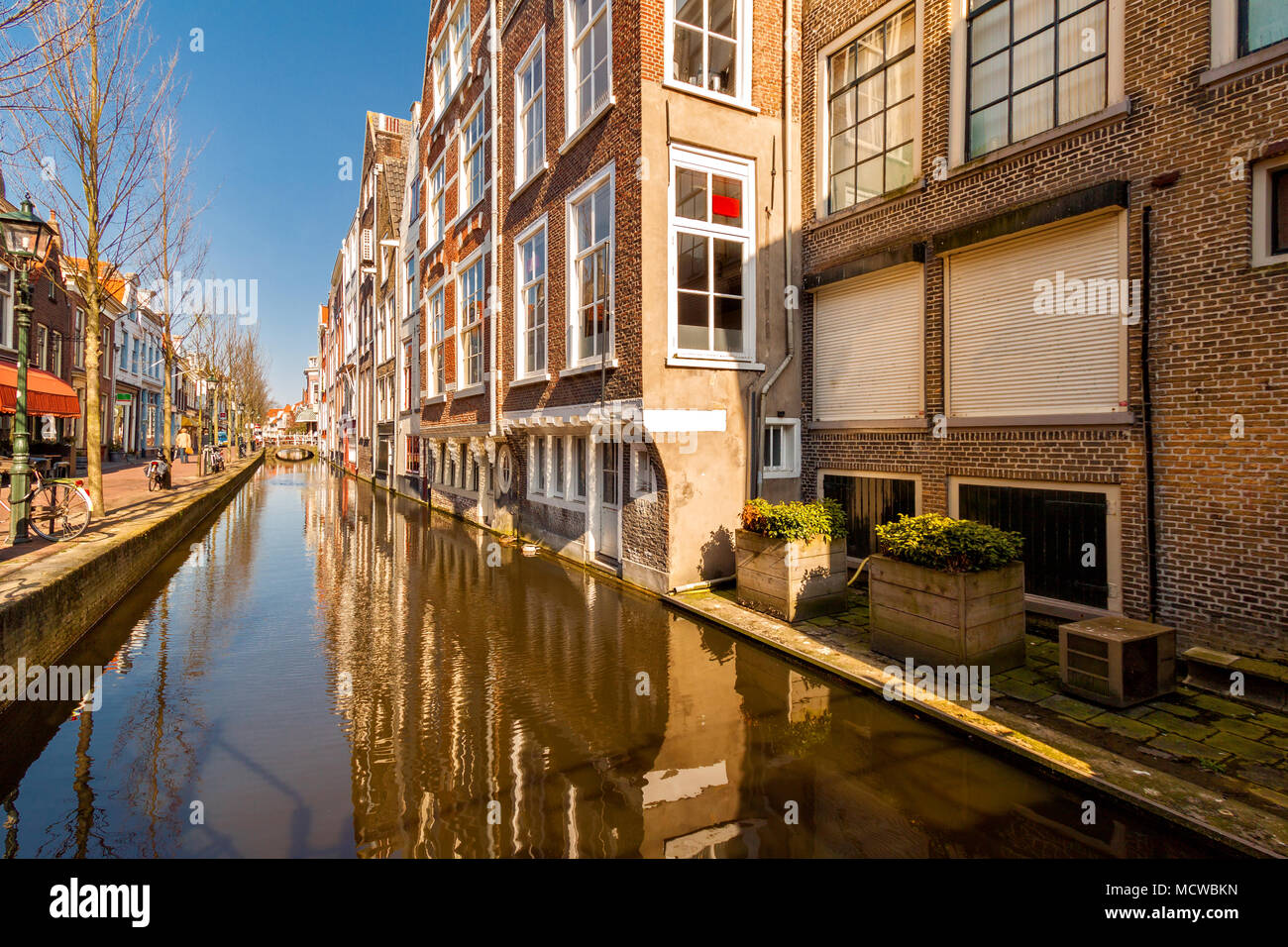 Canal along Voldersgracht street, in the old center of Delft Stock Photo