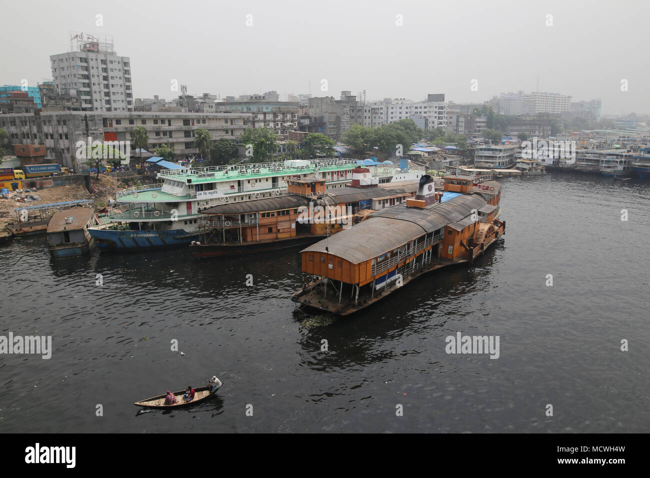 Dhaka, Bangladesh. Steamers (ship) anchored in the Buriganga River in Dhaka, Bangladesh on April 17, 2018. Thousands people cross the Buriganga river everyday, which is becoming deadly river as the chemical waste of mills and factories, household waste eventually makes its way into the Buriganga River. © Rehman Asad/Alamy Stock Photo Stock Photo