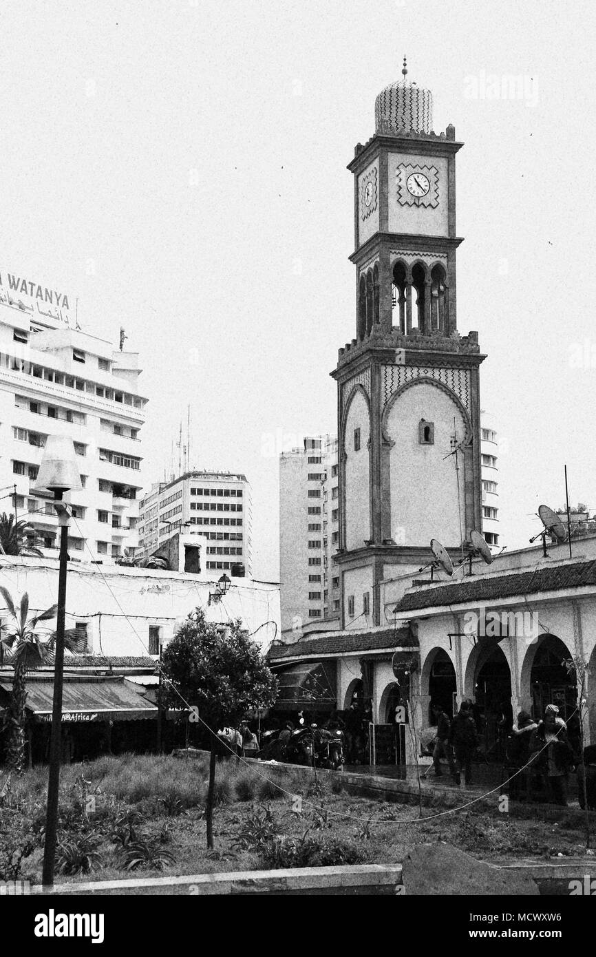 Old fashioned black and white picture of the clock tower at the entrance of the old souk in Casablanca, Morocco - Stock Image