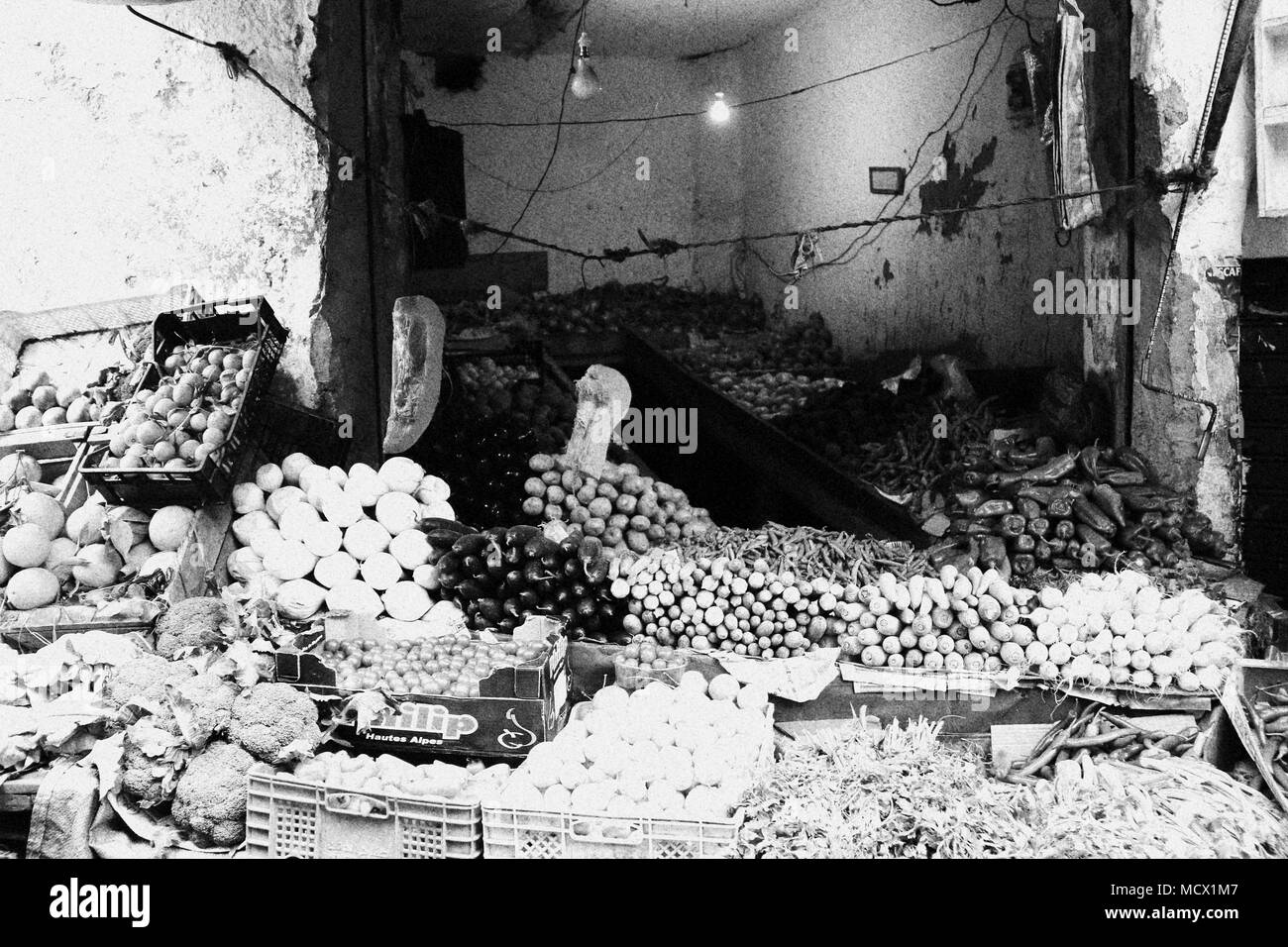 Old fashioned black and white picture of a market stall having vegetables on sale at the old souk in Casablanca, Morocco - Stock Image