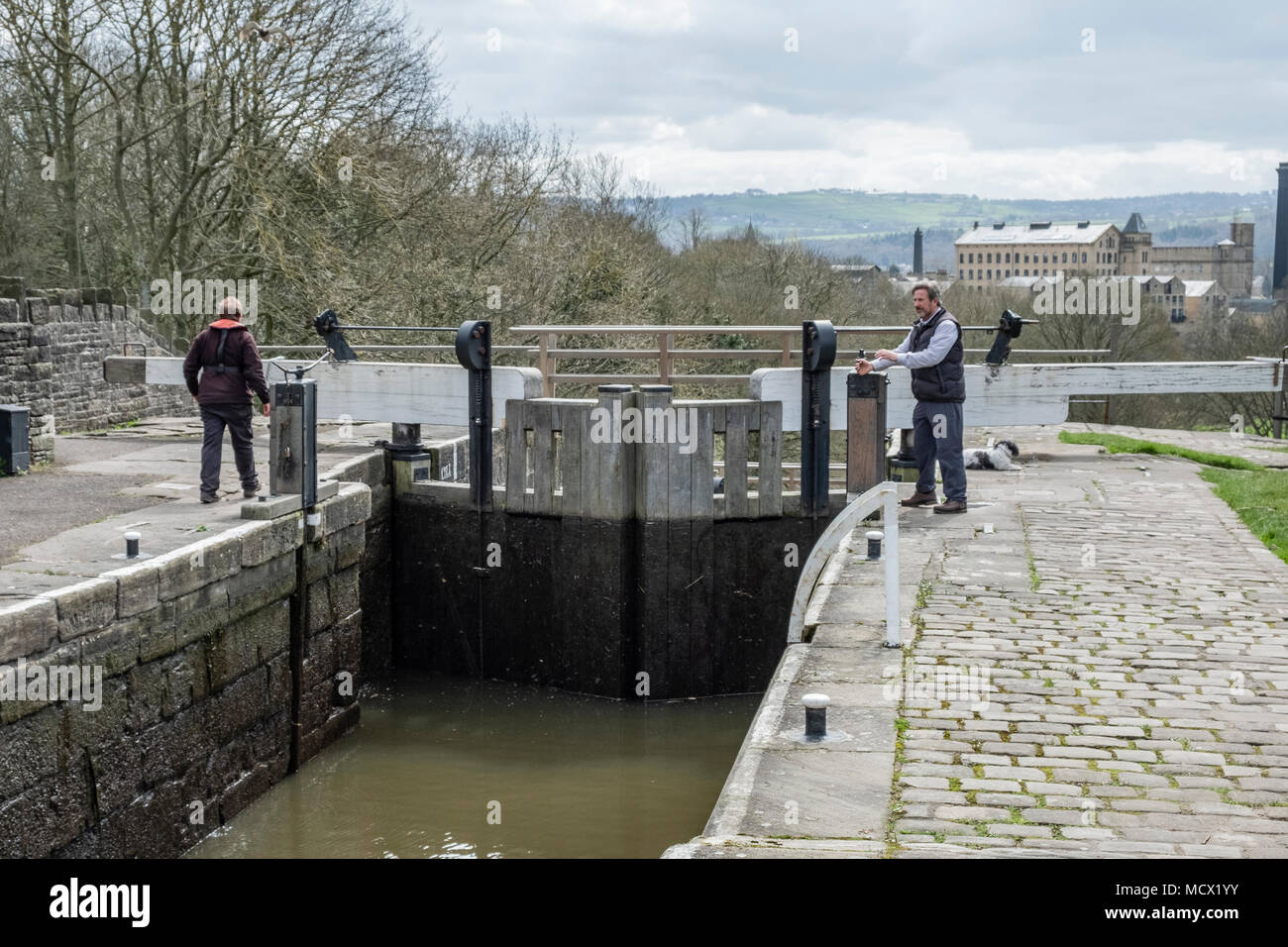 Lock Keepers on The Five Rise Locks on the Leeds and Liverpool Canal,  Bingley, near Bradford, West Yorkshire, England. - Stock Image