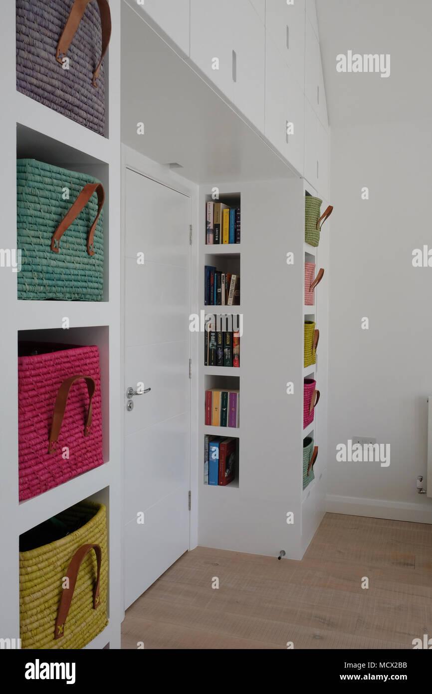 Scandinavian inspired, light-filled bedroom interior showing wooden ...