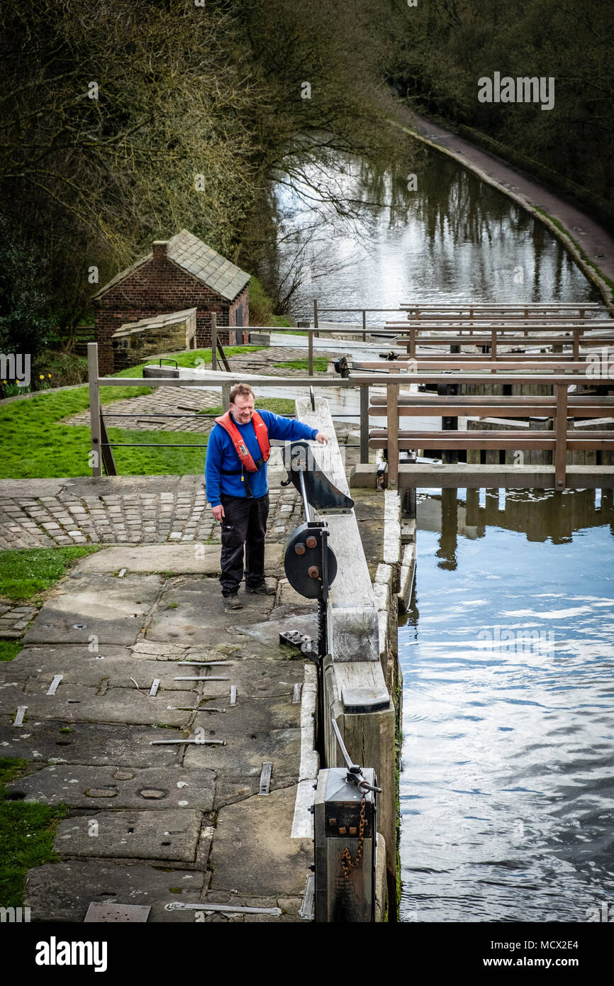 The Lock Keeper on The Five Rise Locks on the Leeds and Liverpool Canal,  Bingley, near Bradford, West Yorkshire, England. - Stock Image