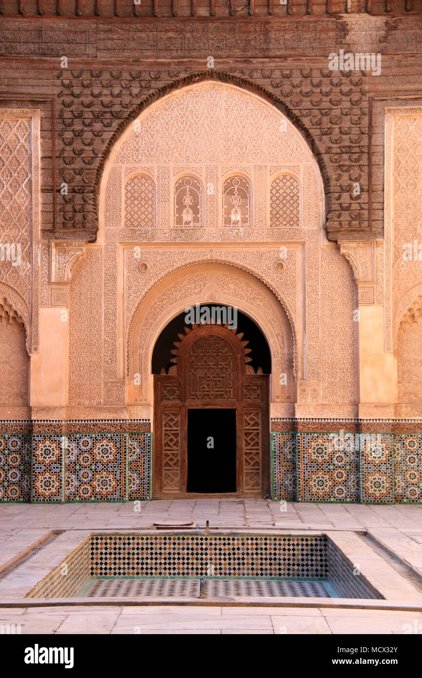 Entrance to the colonnade around the inner courtyard of the Ben Youssef Madrasa (Qur'anic school) in Marrakesh, Morocco Stock Photo