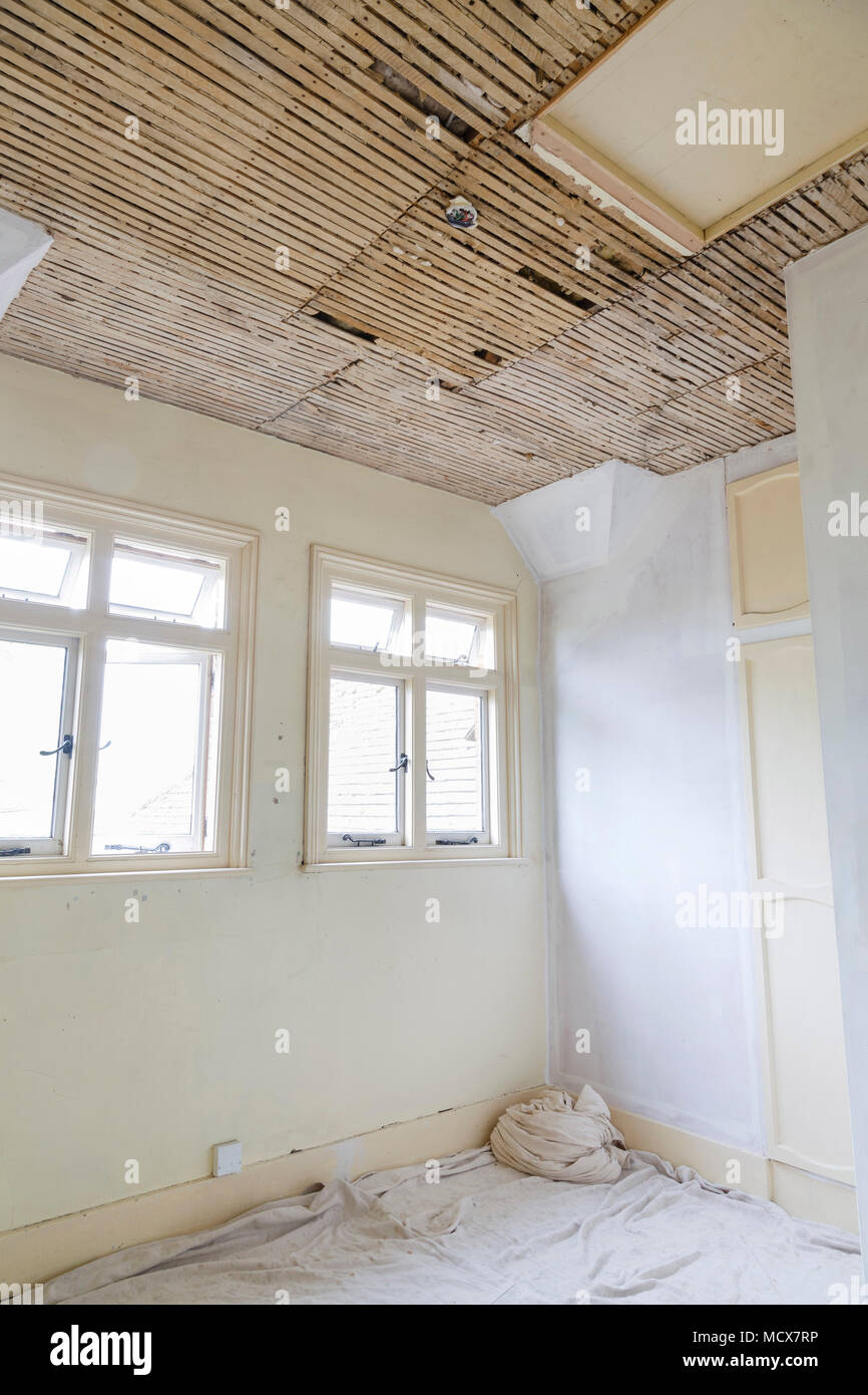 Home improvement repairing plaster and lath ceiling - Stock Image