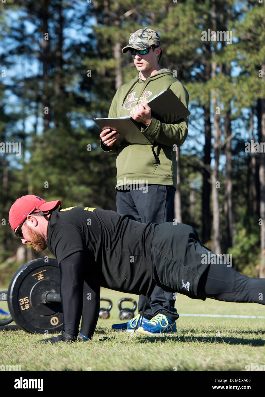 Coach Jacob Crouch with the South Carolina National Guard Warrior Fitness Program demonstrates the proposed Army Combat Readiness Test (ACRT) at McCrady Training Center, Eastover, South Carolina, Mar. 4, 2018. (U.S. Army National Guard photo by Sgt. Brian Calhoun, 108th Public Affairs Detachment) - Stock Image