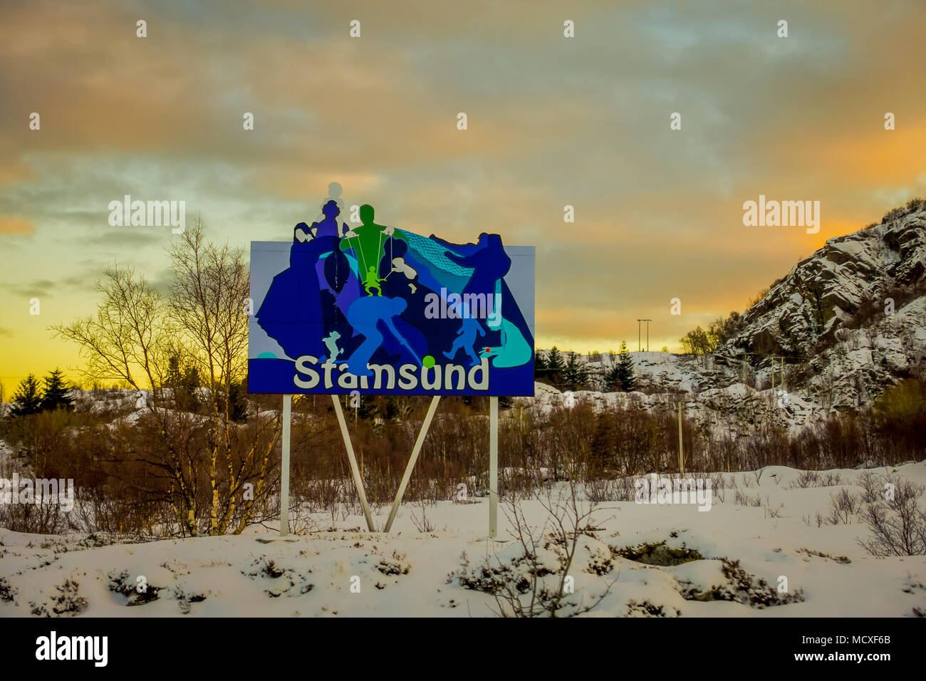 STAMSUND, LOFOTEN, NORWAY, APRIL, 09, 2018: Outdoor view of huge placard of diferent images in a gorgeous sunset background surropunding of nature in Lofoten island - Stock Image