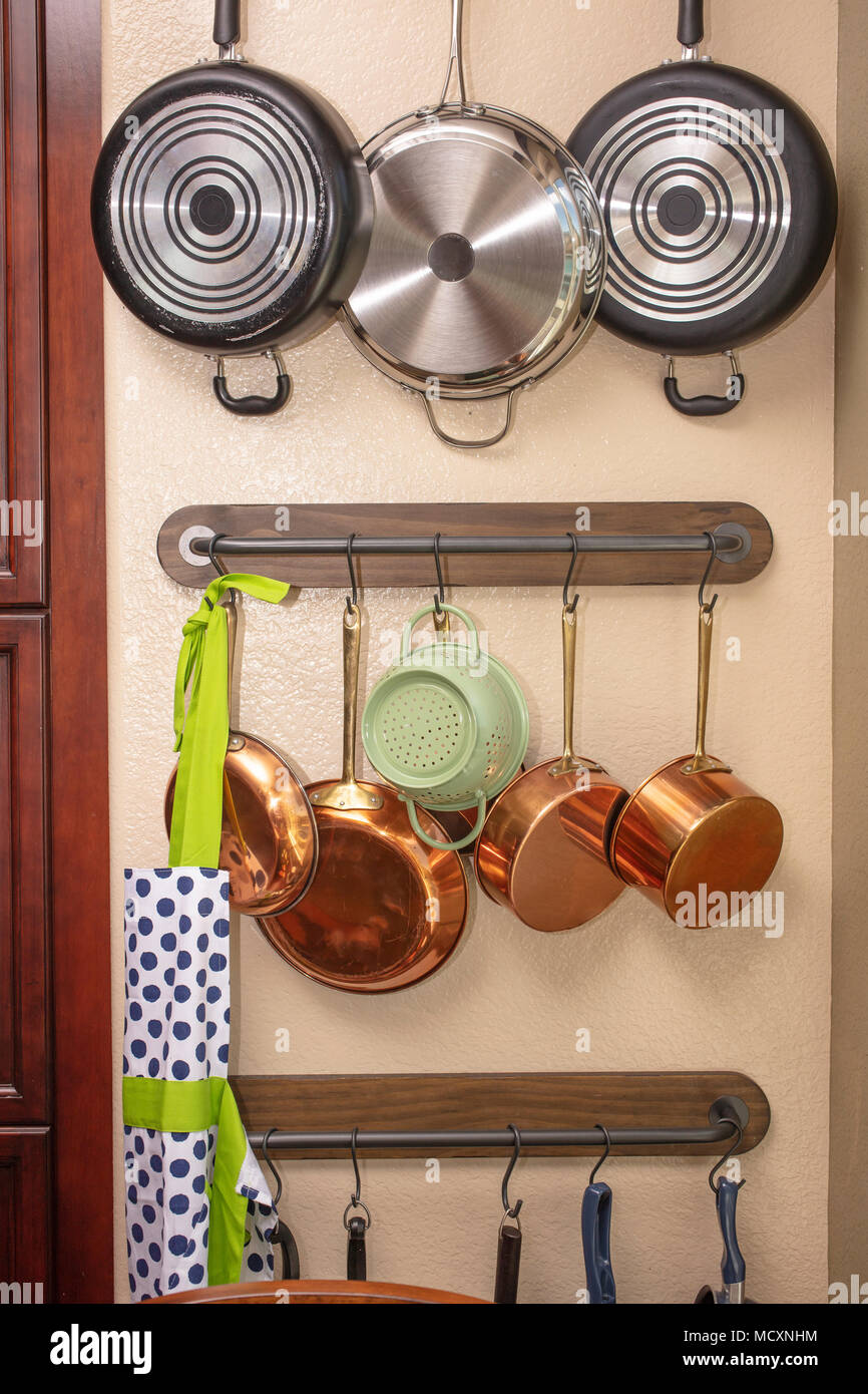 Pots and pans hanging on a kitchen