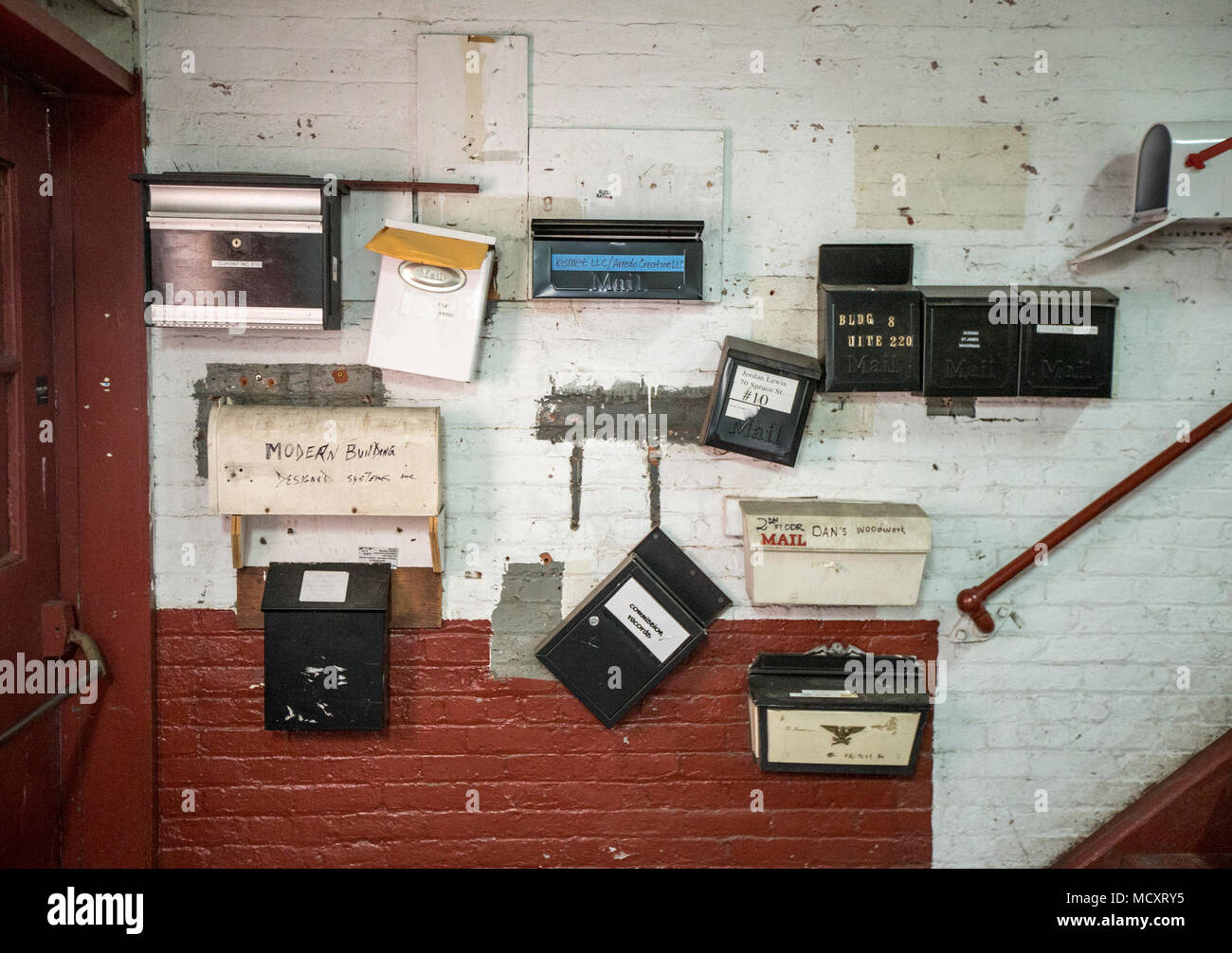 Mailboxes in an old warehouse building - Stock Image