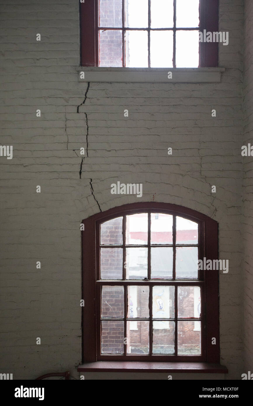 A crack in interior wall of a warehouse - Stock Image