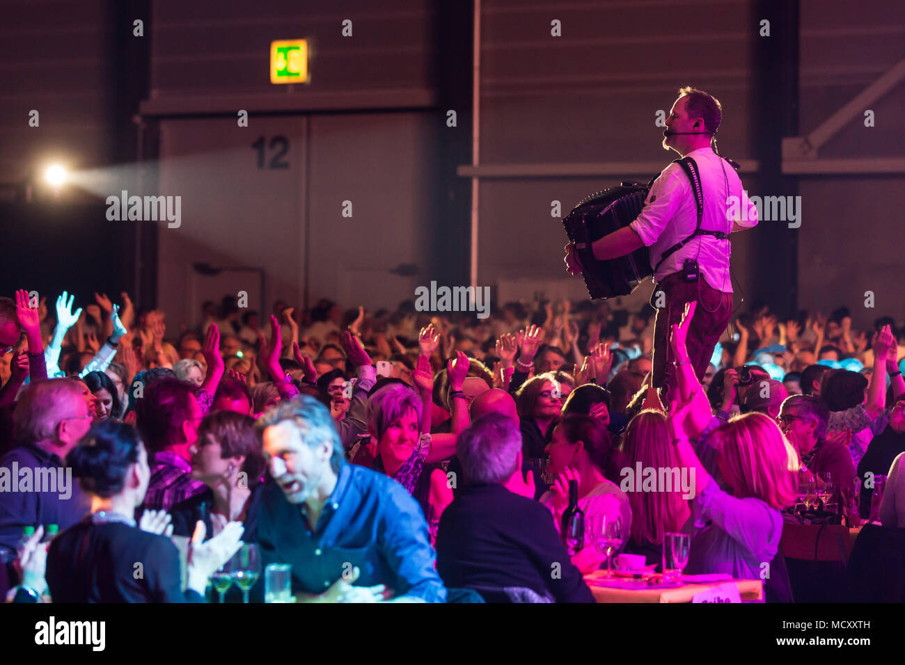The Duo Alpenwind with Gerd Winkler on accordion in the midst of fans live at the 16th Schlager Nacht in Luzern, Switzerland - Stock Image