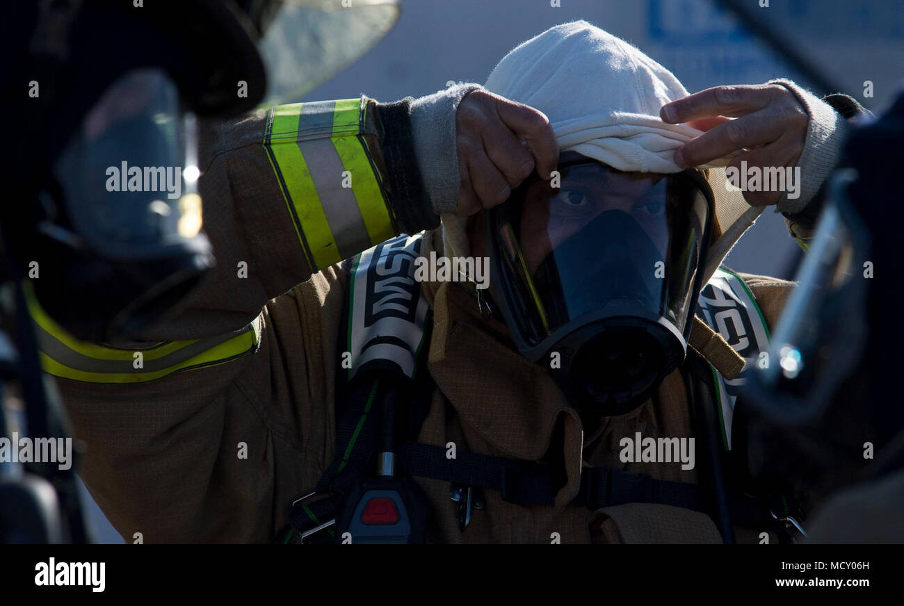 Captain Korell Cooper, Shreveport Fire Department firefighters, gears up for an annual recertification burn at Barksdale Air Force Base, La., March 21, 2018. Utilizing the burn pit on Barksdale allows the SFD to save approximately $30,000. - Stock Image
