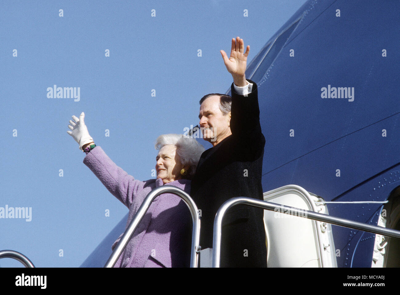 Inauguration a final farewell - former President and First Lady George and Barbara Bush give one final goodbye wave prior to boarding Air Force One.  Approximately 600 well wishes were present for the departure at Andrew Air Force Base, Maryland on Inauguration day. - Stock Image