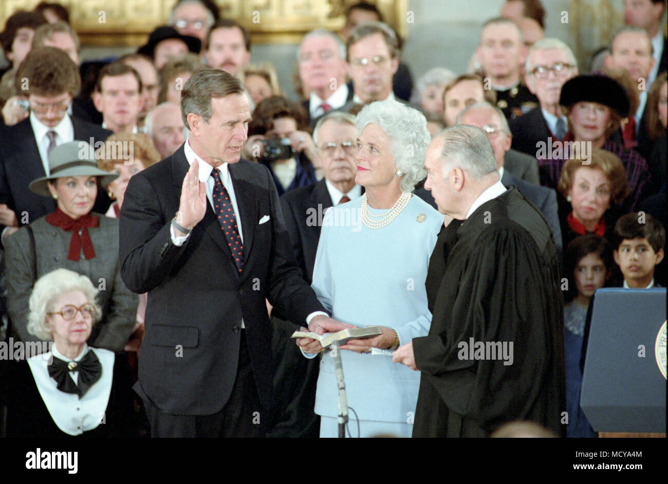 1/21/1985 Vice President Bush taking his oath of office with Justice Potter Stewart with Barbara Bush looking on in the US Capitol - Stock Image